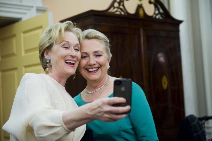 Actress Meryl Streep uses her iPhone to get a photo of her and Secretary of State Hillary Rodham Clinton following the State Department Dinner for the Kennedy Center Honors gala Saturday, Dec. 1, 2012 at the State Department in Washington. (AP Photo/Kevin Wolf)